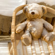 Foto Stock: Teddy Bear toy and slide with snow covering