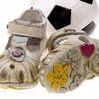 Stock Photo: Baby football shoes and ball on white background