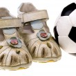 Baby football shoes and ball on white background — Stock Photo