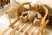 Teddy Bear toy and slide with snow covering — Stock Photo