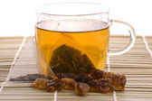 White tea, nylon tea-bag and sugar — Stock Photo