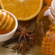 Fresh honey with honeycomb, spices and fruits — Stock Photo