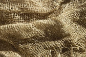 Sunny burlap background — Stock Photo