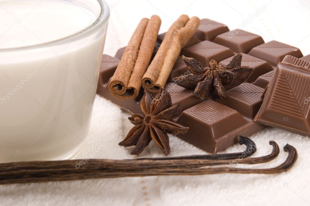 Sensuality spa chocolate aromatherapy items - towel, milk, chocolate, anise stars, vanilla, cinnamon, cacao, coffee — Stock Photo #1780474