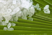 Bath salt and palm leaf — Stock Photo