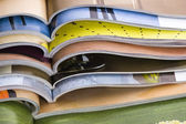 Stack of open magazines — Stock Photo
