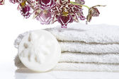 Spa items with white towels, natural soap and or — Stock Photo