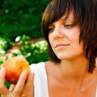 Woman and a Peach — Stock Photo
