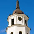 Church tower clock in Vilnus — Stock Photo