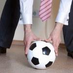 Boss playing football — Stock Photo