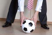 Boss playing football — Stock Photo
