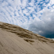 Sand meets sky - Stock Photo