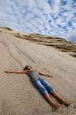 Lying on sand — Stock Photo