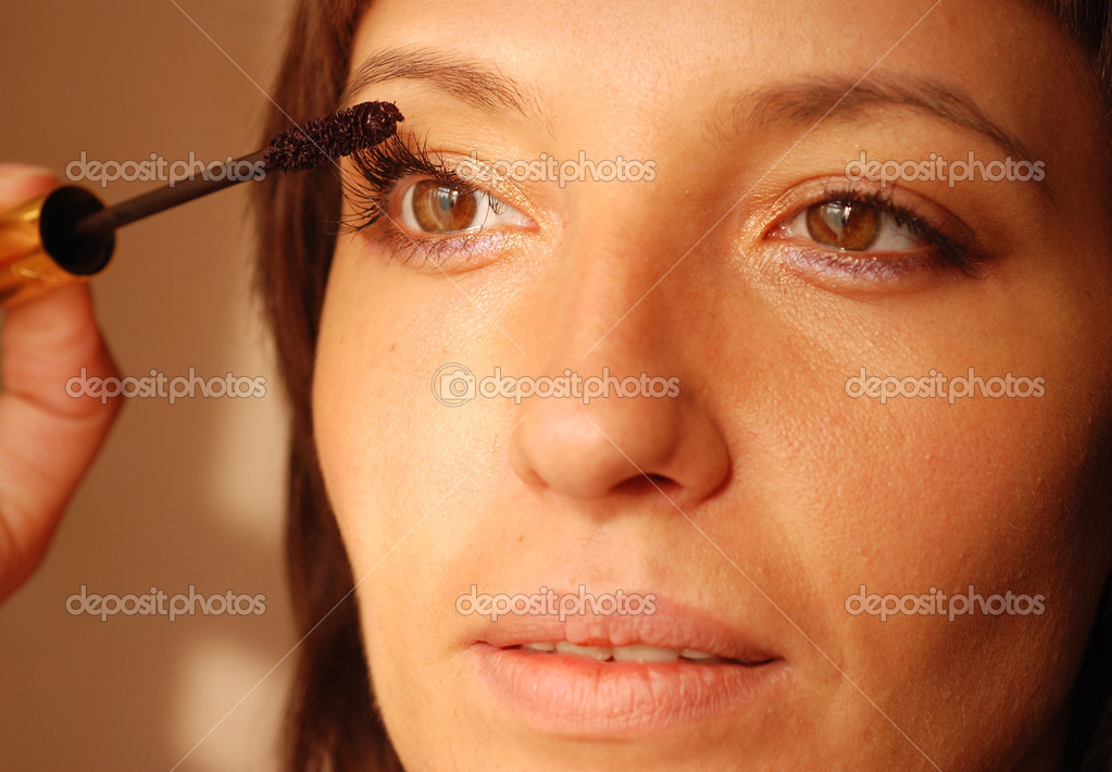 Women make eye make-up.  Stock Photo #2681776