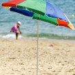 Stock Photo: Striped umbrellon sandy beach