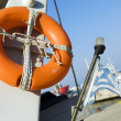Old life buoy on the boat — Stock Photo