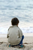 Lonely Kid on the beach — Stock Photo