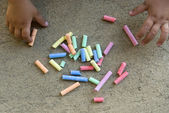 Chalks and kid hands — Stock Photo