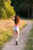 Girl walks on a footpath — Stock Photo