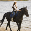 Woman ride the horse - Stock Photo