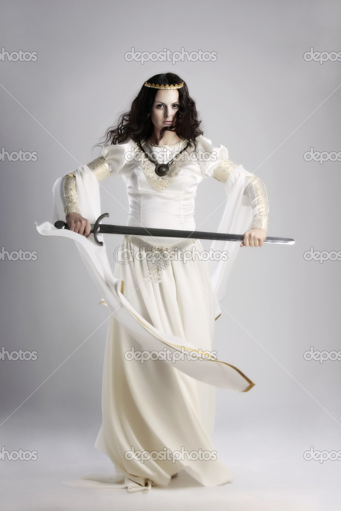 A lady with sword in traditional medieval dress  Stock Photo #1822254