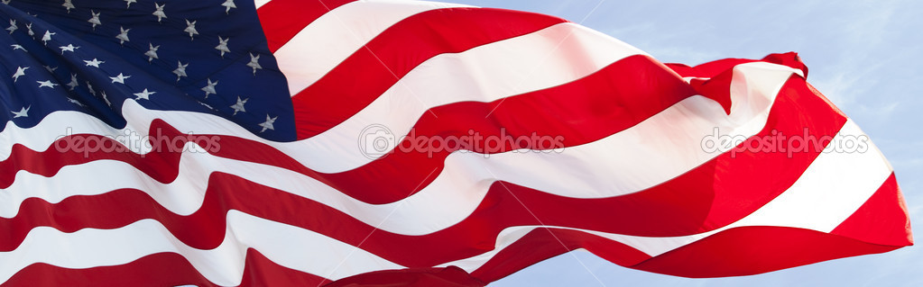Photo of American flag waving in the wind — Stock Photo #1775974