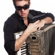 Male with accordion and gun — Stock Photo