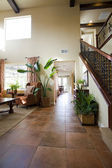 Hallway of luxury house with lots of natural light — Stock Photo
