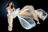 Beautiful woman wrapped in silk fabric — Stockfoto