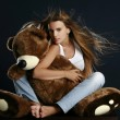 Stock Photo: Young pretty woman with big teddy bear