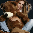 Young pretty woman with big teddy bear — Stock Photo