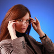 Business-woman on blue — Stock Photo #1777403