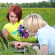 Girls in grass - Stock Photo