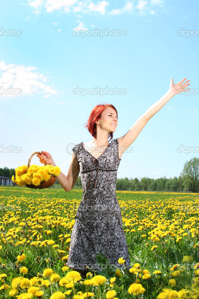 Beautiful redhead girl with basket of dandelions  Stock Photo #1805091