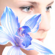 Eye and orchid — Stock Photo