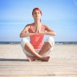 Young woman meditating on the beach — Stock Photo #1814347