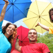 Funny colorful friends with umbrellas — Stock Photo #1835920