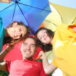 Funny colorful friends with umbrellas — Foto Stock