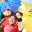 Stock Photo: Funny colorful friends with umbrellas