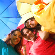 Funny colorful friends with umbrellas — ストック写真