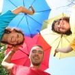 Funny colorful friends with umbrellas — Stok fotoğraf