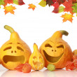 Pumpkins with funny faces on white — Stock Photo