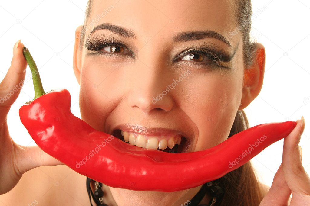 Beautiful woman with red hot pepper — Stock Photo #2436596