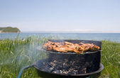 Barbecue & sea — Stock Photo