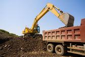 Excavator & truck — Stock Photo