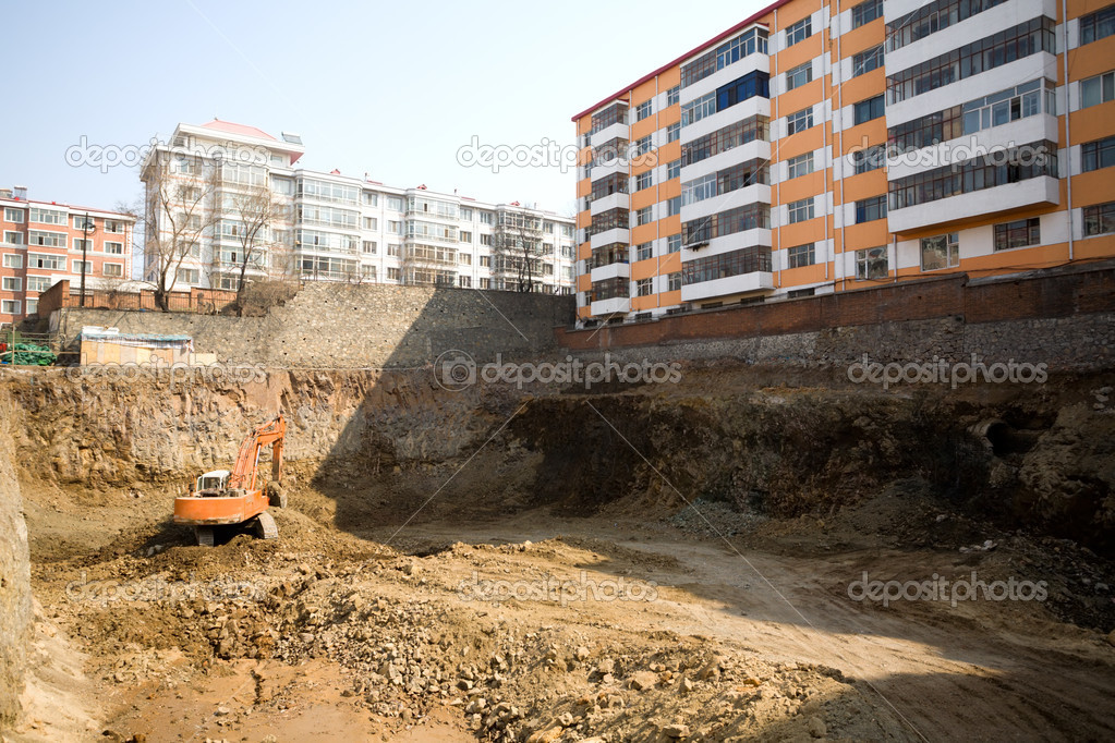 City.Workplace.Trench of a new building.Tractor Excavator. — Stock Photo #1801950