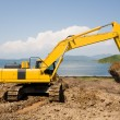 Excavator on a working platform — Stock Photo