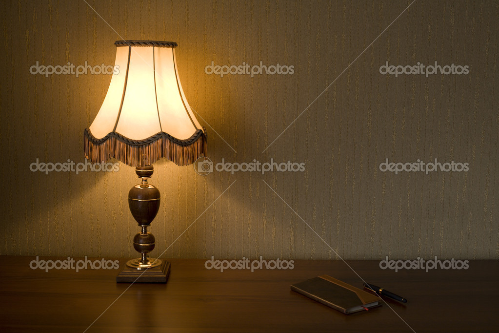 Lamp Shade, notebook and pen on a working table. — Stock Photo #1850413