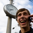 Stock Photo: Clock.man.mobile