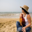 Young woman and guitar. Beach — Stock Photo
